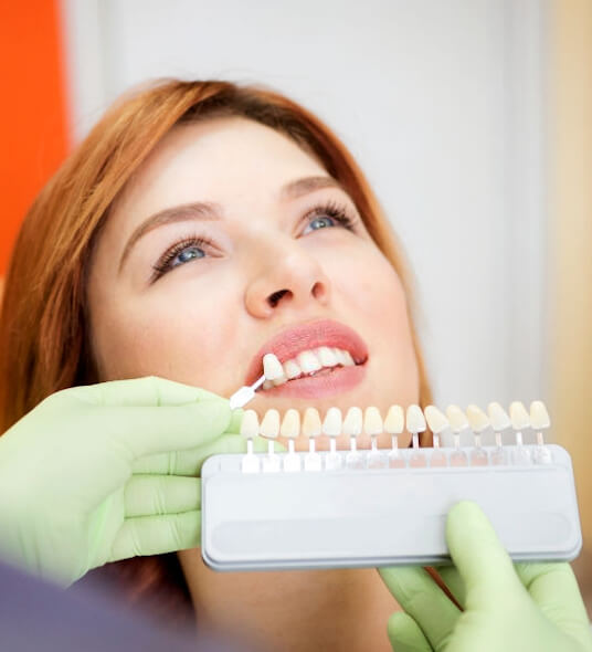 TOOTH COLORED PORCELAIN DENTAL CROWNS